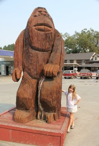 Maile and the fourth Willow Creek Sasquatch statue.